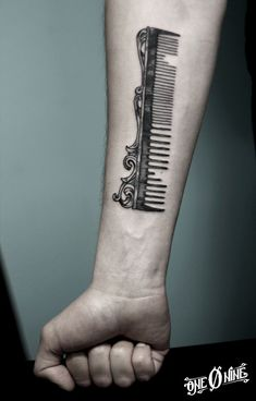 A comb, definitely! Tattoo by 109