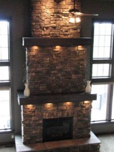 Imagine coloured cushions and rustic toned blankets around this fireplace on a chilly fall evening