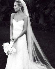 Love the dress and long veil!