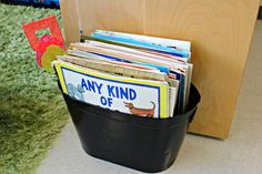 This is my beloved big book tub.  It has been 3 colors over the years.  I got it at Target in the garden section.  It was royal blue metal.  It was 15 dollars and I remember I did not have the money to splurge on it but I knew that I just had to do it.  This was money well spent!