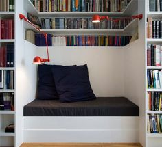 """""""The reading nook that separates the dining from the living room is completely wrapped in books"""" - Elizabeth Roberts, bookcase with built in bench, Fort Greene townhouse remodel, Remodelista Home Living, Living Spaces, Living Room, Estilo Interior, Decoration Inspiration, Home Libraries, Cozy Nook, Cosy, Cozy Corner"""