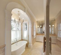 aged mirror wall with mirror on top and arched ceiling in bead board in tub alcove.  Love.