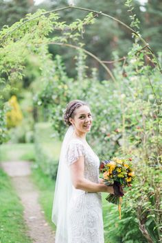 Holly wore an Eliza Jane Howell gown for her colourful, outdoor wedding in Scotland