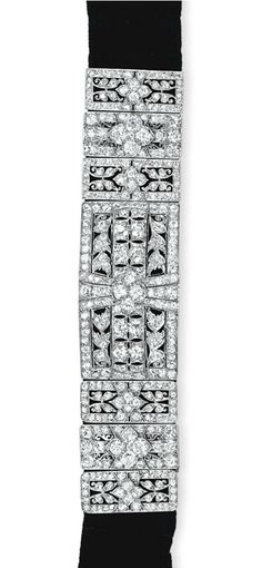 A DIAMOND CHOKER NECKLACE   The front designed as an old European and old mine-cut diamond plaque to the black velvet choker band and diamond-set bar clasp, mounted in platinum, 13 ins. Edwardian or Edwardian style.