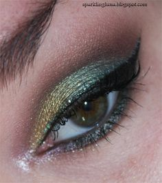 Outer 1/2 of the lid and outer crease (blended) : Sleek Fauna Middle of the lid : Sleek Evergreen Crease , blended up : Sleek Entwined Outer V and darken the crease : Sleek Flora Inner lid : MAC Old Gold pigment , applied with a damp brush Inner corner and inner lower lashline , applied with a damp brush : Sleek Eve's Kiss