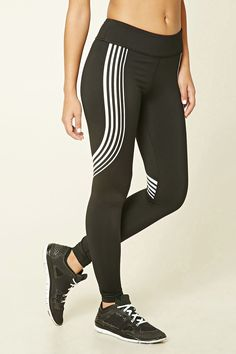 A pair of knit leggings featuring athletic-inspired stripes, an elasticized waist, hidden key pocket, back zipper pocket with reflective trim, and moisture management.