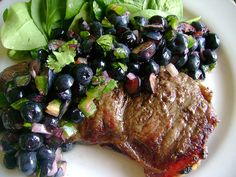 Blueberry Salsa from Sweet Cheeks  2 cups fresh blueberries, coarsely chopped  1 medium shallot, finely chopped  1 jalapeno, seeded and minced  1 tablespoon fresh cilantro, chopped  1 lime, squeezed for juice  1 teaspoon fresh ginger, minced  1/4 teaspoon salt