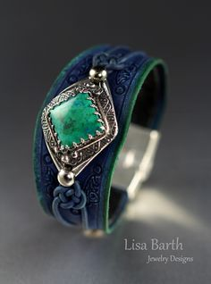 Chrysocolla stone bezel set in fine silver with a hand made leather bracelet to go with itl  Lisa Barth