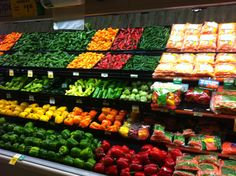 Rainbow of veggies welcome me into the store