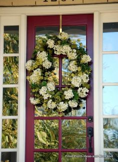 Lovely hydrangea wreath adorns this red front door :: Front-Porch-Ideas-and-More.com #wreath #hydrangeas