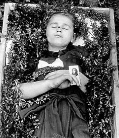 Post mortem photo with coffin.