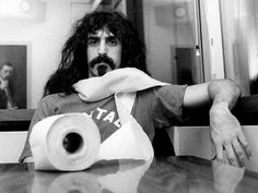 Frank Zappa can rock the toilet paper scarf