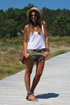 Green shorts, white tank, and gladiator sandals