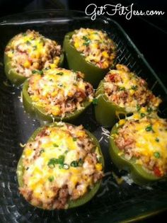 Easy healthy dinner ~ stuffed peppers! Bake in oven w/ ground turkey, tomato sauce, & cheese.