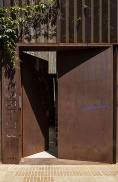 Image 7 of 16 from gallery of Pasaje Cabrer Collective Housing / AFRa. Photograph by Federico Kulekdjian Entrance Gates, Main Entrance, Entry Doors, Industrial House, Industrial Interiors, Facade Architecture, Contemporary Architecture, Fence Design, Door Design