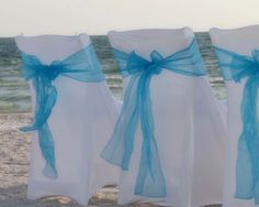 Chairs covers with a classic turquoise sash