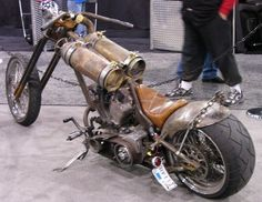 SCUBA tanks for gas tanks?  True rat bike.  Dig the mini sissy bar made from a length of chain.