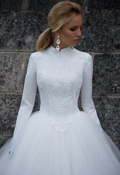 Oksana Mukha 2017 bridal collection ... I can hear the Sound of Music here. Glorious modern take on the modest winter ball gown wedding dress. ( close-up of bodice lace)