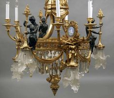 For Sale on - A unique late century gilt and patina bronze, crystal and wedgwood porcelain thirteen-light chandelier. Antique Brass Chandelier, Antique Lamps, Antique Lighting, Chandeliers, Chandelier Lighting, Arrow Of Light Award, Arrow Of Lights, Globe Pendant, Glass Globe