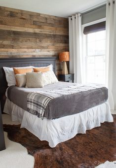 DIY headboard wall clad with pallet wood