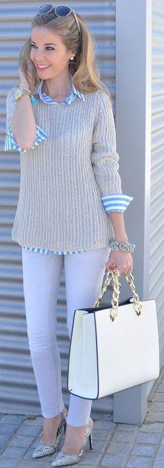 Lilac pants, pinstripe blouse, sweater, great bag.
