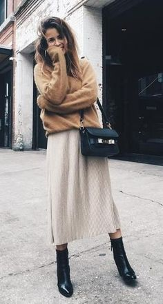 street style. kits. midi skirt. ankle boots.