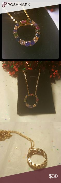 VTG Infinity Rhinestone Circle Necklace Pictures do not do this beautiful necklace justice. This is a beautiful vintage infinity circle necklace with multicolored rhinestones. I have an extender for free if u need one. Just tag me and let me know. Other wise 18 inch chain. Pendant is 3/4 inches across. Mint condition. Vintage Jewelry Necklaces