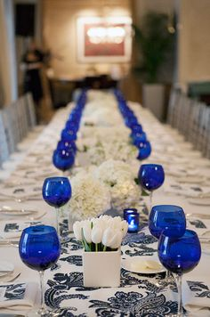 Monofloral arrangements of tulips and hydrangeas are placed in modern square vessels. #WeddingCenterpieces