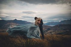 Breathtaking Queenstown Elopement amongst the Southern Alps of New Zealand. Wind, Mountains, Lakes,Helicopters, Stunning couple and much love. Jim Pollard.