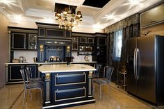 Unique #Kitchen Idea of the Day: Black cabinets with gold leaf trim.