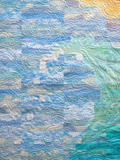 """Quilting close-up: 'Waving' by Emma How, Sampaguita quilts:  """"I quilted feathers over the break of the wave to accentuate it, then filled the background with swirls"""""""