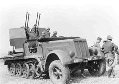 A SdKfz 7/1 variant with 20mm Flakvierling 38 L/65 anti aircraft gun mounting with shield