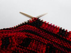 Ravelry: Not Your Average Pick-Up pattern by Debra Belletete.  Utilizes a way to avoid picking up stitches along the edge of your work.  Instead the stitches are knit onto the cable as you go.