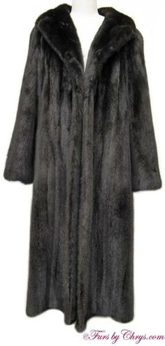 SOLD! Ranch Mink Coat #RM723; Excellent Condition; Size range: 10 - 14. This is a gorgeous genuine natural ranch mink fur coat. It features a full notched collar and beautiful belled sleeves. There are two exterior velvet-lined pockets. There is NO MONOGRAM. It has an open design (no closures). The mink fur is very silky soft and shiny. It appears to have been very rarely worn and is in pristine condition. you will reach for this fashionable ranch mink coat!