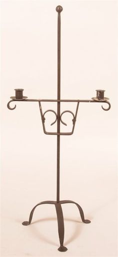 "19th/20th Century Wrought Iron Adjustable Candle Stand. Tripod base with penny feet. 29""h. overall."
