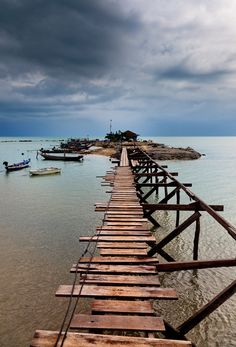 Storm over a boat house along Lamai beach in Ko Samui_ Thailand