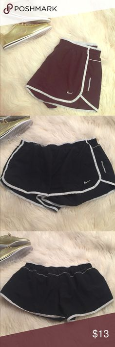 Nike Running shorts with briefs EUC Nike running shorts. Black with white piping. Have been worn before, but show no signs of wear other than size tag fading. Great deal! Nike Shorts