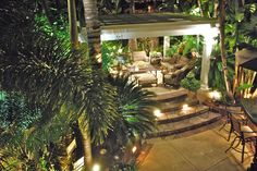 Tropical outdoor Living with Landscape Lighting and Cabana