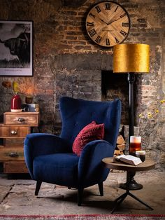 Add a little luxe to a rustic interior with a contrasting velvet chair. The Delon chair combines style and comfort with its high winged back and soft upholstery.