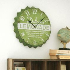 Awesome bottle cap clock!!! For the sun room. And I believe my friend STan has one in his booth at Plethora. Ooo...must go get that.
