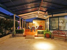 outdoor flooring | outdoor living design with bbq area & hedging using tiles - Outdoor ...