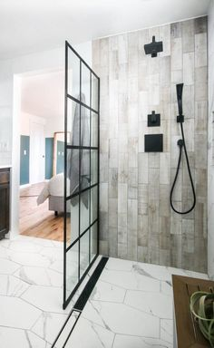 This shower design makes the bathroom feel so luxurious and like the relaxing oasis that we are aiming to create. I love the white carrara marble hexagon tile mixed with the wood look tile on the side shower walls. Bad Inspiration, Bathroom Inspiration, Home Decor Inspiration, Bathroom Ideas, Bathroom Styling, Decor Ideas, Craft Ideas, Diy Shower Installation, Shower Pan Liner