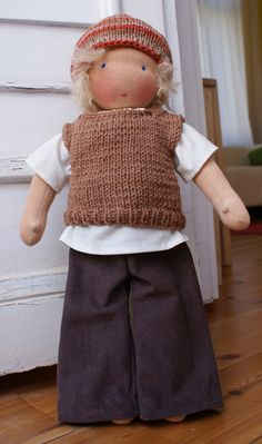 Waldorf doll.....I think I might need to learn to knit, too.