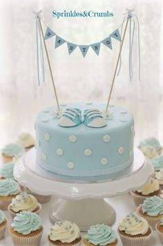 baby shower blue and white themed cake with polka dots and bunting.: