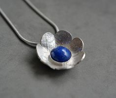 Sterling silver flower necklace with lapis by Kailajewellery
