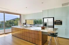 example of kitchen island with lip at end for stools. cool timber cabinetry too