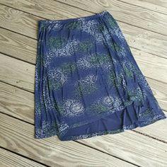 Blue patterned skirt.  Plus size Plus Size 1x.  Coldwater Creek.  Acetate and spandex blend.  Elastic waist.  27 inch length.  Irregular hemline. Coldwater Creek Skirts Asymmetrical