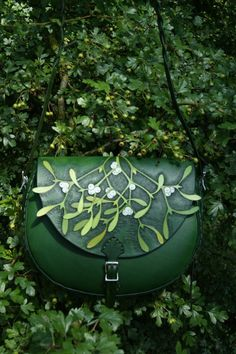 Double carved mistletoe boho on deep green leather with buckled flap