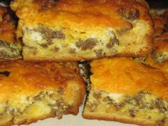 Sausage Breakfast Bars - Press croissant dough in the bottom and sides of a pan. of breakfast sausage. Whip 4 eggs together and season with salt and pepper. Sprinkle cheese on top. Bake until the eggs are done on Cut and enjoy! No fork needed. What's For Breakfast, Sausage Breakfast, Breakfast Dishes, Breakfast Recipes, Breakfast Pizza, Breakfast Sandwiches, Savory Breakfast, Breakfast Casserole, Breakfast Croissant