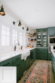 Kitchen Cabinet Inspiration A round-up of the best green kitchen cabinet paint colors for the hottest bold kitchen color trend.A round-up of the best green kitchen cabinet paint colors for the hottest bold kitchen color trend. Green Kitchen Cabinets, Painting Kitchen Cabinets, White Cabinets, Colored Cabinets, Green Kitchen Paint, White Counters, Kitchen Walls, Light Green Kitchen, Kitchen Sink